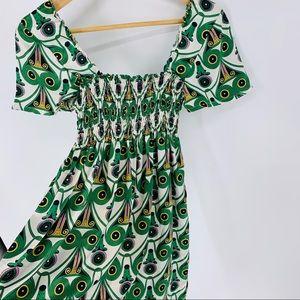Art Deco print off the shoulder mini dress